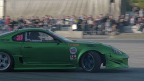 Drifting competition in the city. NOVOSIBIRSK, RUSSIA - JUNE 03, 2016: Sport cars driving on race track and demonstrating drifting skills stock video