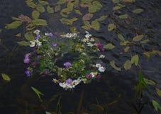Drifting Flower Chain on Midsummer Night Stock Photo