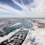 Drifting ice floe on the spring river, top view Stock Photos