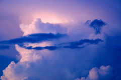 Drifting intense blue and white sunset clouds Stock Photography