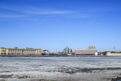 Drifting on the Neva River. Blue sky and white ice stock photography