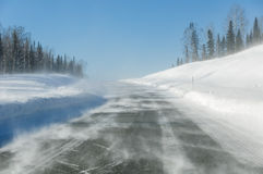 Drifting snow road snowdrifts Stock Photos