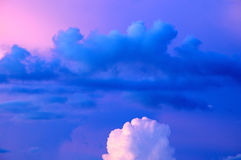 Drifting vibrant blue and white sunset clouds Royalty Free Stock Photo