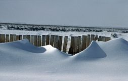 Drifts behind snow fence #1 royalty free stock photo