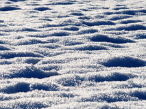 Drifts of frosty snow crystals. Layers of snow crystals from a field on a cold winters day Stock Photography