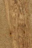 Driftwood Background Texture Abstract - wood in sand. Natural Wood from beach as a background texture - rusty nails, pale grain pattern, with sand royalty free stock images
