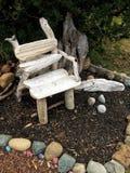 Driftwood chair. Wooden garden chair Stock Photos
