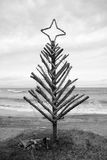 Driftwood Christmas Tree, Pouaua Beach, Gisborne, New Zealand. Vertical portrait  format black and white photograph of driftwood Christmas Tree made by Royalty Free Stock Images