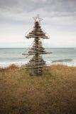 Driftwood Christmas Tree, Pouaua Beach, Gisborne, New Zealand. Vertical portrait format colour photograph of driftwood Christmas Tree made by summertime freedom stock photo