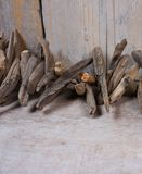 Driftwood and quail eggs on wooden background royalty free stock photos