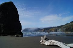 Oregon Coast Driftwood and Boulder Stock Photo