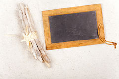 Driftwood and Slate Blackboard in the Sand Royalty Free Stock Photo