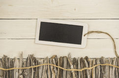 Driftwood and a tablet decorated on a white wood backbround Royalty Free Stock Photography