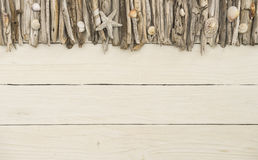 Driftwood with white wooden background Royalty Free Stock Photography