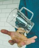 Drijvend glas over hand royalty-vrije stock afbeeldingen
