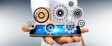 Drijvende het toestelpictogrammen van de zakenmanholding in zijn hand het 3D teruggeven Stock Afbeelding