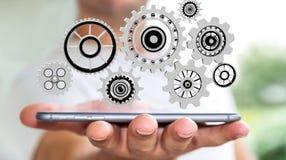 Drijvende het toestelpictogrammen van de zakenmanholding in zijn hand het 3D teruggeven Stock Afbeeldingen