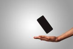 Drijvende mobiele geïsoleerde telefoon Royalty-vrije Stock Afbeelding