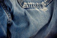Dril de algodón defectuoso del fondo de los vaqueros con una costura de la textura del dril de algodón del diseño de la moda del  imágenes de archivo libres de regalías
