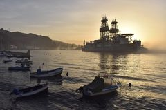 Driling ship and boats in morning mist Tenerife Canary Islands royalty free stock images