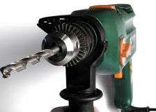 Drill. Green  drill with boring bit Royalty Free Stock Photo