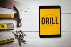 Drill against blueprint Stock Image