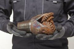 Drill bit in hands Stock Photo