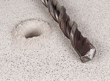 Drill bit. In hole of concrete closeup Stock Photography