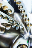 The drill bit, shot close-up with shallow depth of field. Stock Images