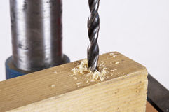Drill-bit at work. Drill-bit with timber at work Royalty Free Stock Images