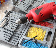 Drill And Bits. This photo shows a drill together with bits and raw plugs Stock Photography