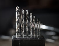Drill bits. A set of dusty drill bits stock photography