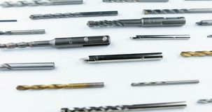 Drill bits of different sizes. Over white background stock video