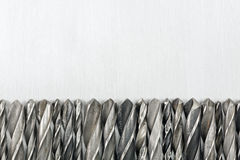 Drill bits on metal background Stock Photos