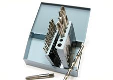Drill bits and taps in a metal box Royalty Free Stock Photo