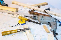 Drill, chisel, measuring tape royalty free stock photography