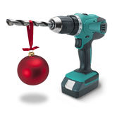 Drill Christmas Gift Tool Tools. A cordless electric drill with a Christmas ornament hanging on the drill bit Royalty Free Stock Photography