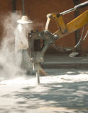 Drill concret machine with employees sweeper  dirty dust Royalty Free Stock Photo