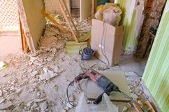 Drill on the dirty and dusty floor in a house under construction. stock image