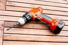 Drill driver on the table. Background image of drill driver on the wood table Stock Photos
