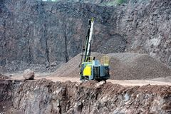 Drill equipment in a open pit mine stock images