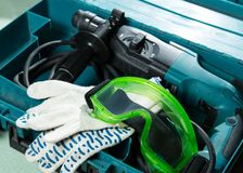 Drill, gloves and goggles Royalty Free Stock Photography