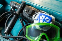 Drill and goggles Royalty Free Stock Photos