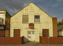 The drill hall at the eastern end of Sidmouth Esplanade. A building which has been deteriorating for many years royalty free stock images
