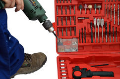 Drill in hand and other tools Royalty Free Stock Image