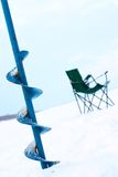 Drill for ice and a chair for winter fishing Royalty Free Stock Photography