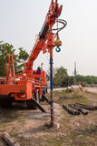 Drill machine. Digging a hole for pole royalty free stock photo