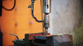 The drill of the machine falls on the material. Factory working stock video footage