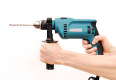 Drill in man hands Royalty Free Stock Images