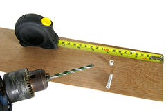 Drill and measuring tape Stock Image